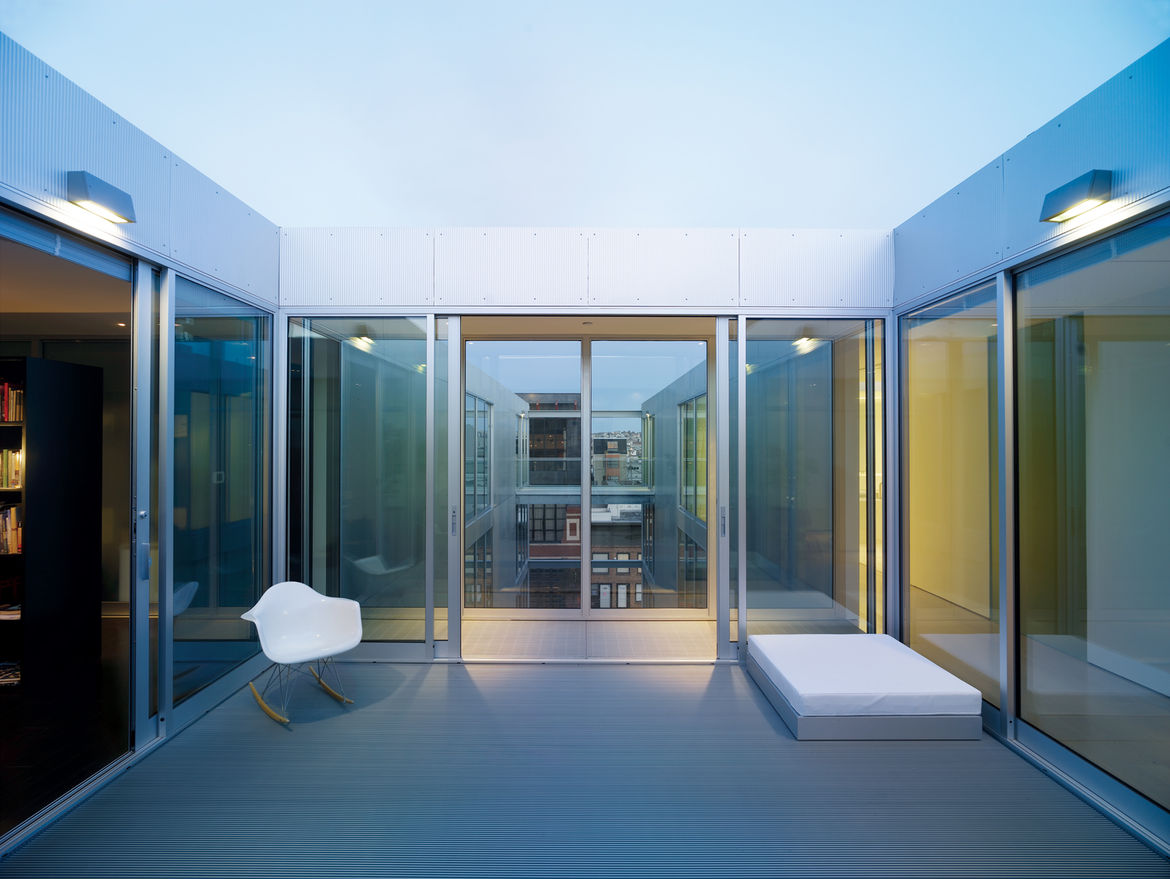 The penthouse boasts an enclosed walkway and a private courtyard—perfect for those sunny San Francisco days that would be warm were it not for the wind. The open space cutting through the center of the building is broken up by transparent footbridges and