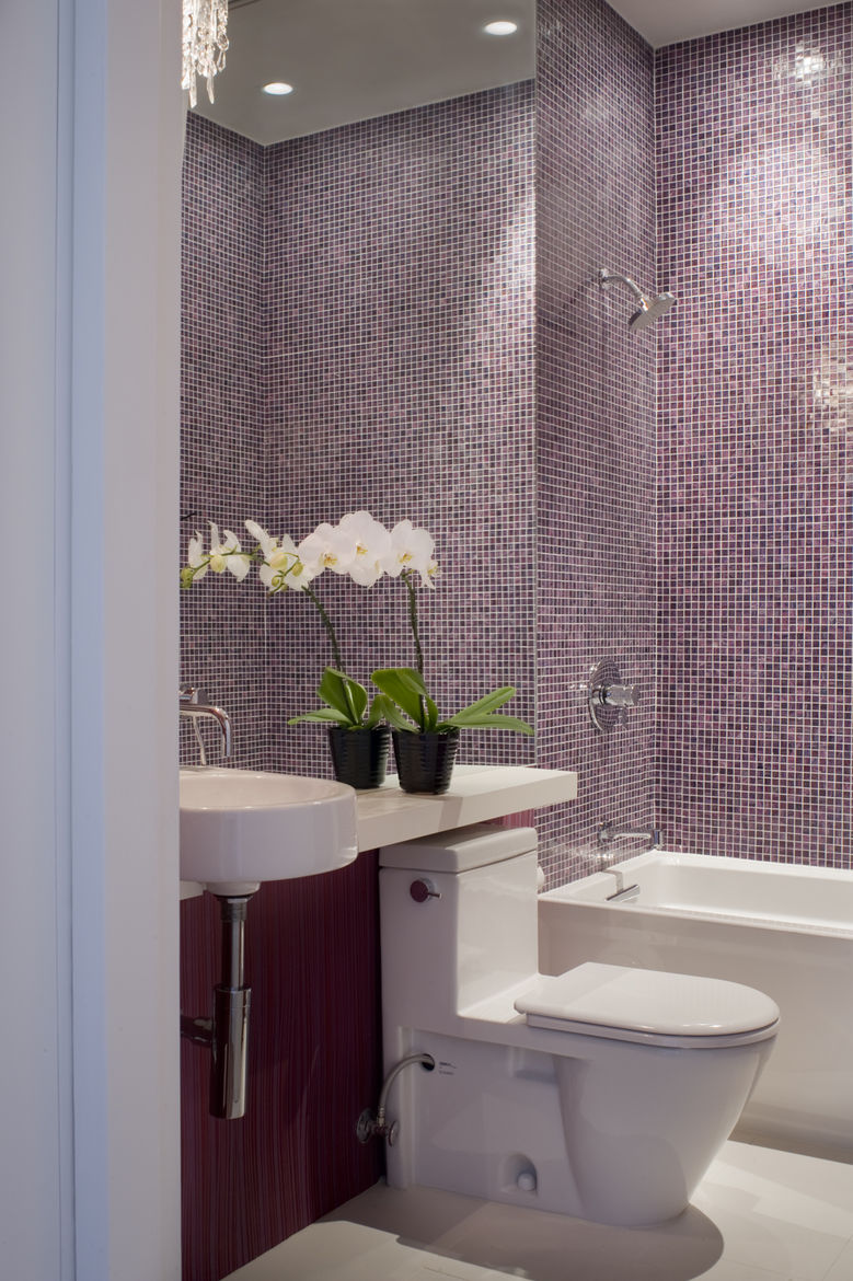 """The main-level bathroom is finished quite similarly to that of the master suite: an Arcitec sink and Stark 2 toilet by <a href=""""http://www.duravit.com/"""">Duravit</a>, a crystal sconce by <a href=""""http://www.eurofase.com"""">Eurofase</a>, and tiles by <a href="""