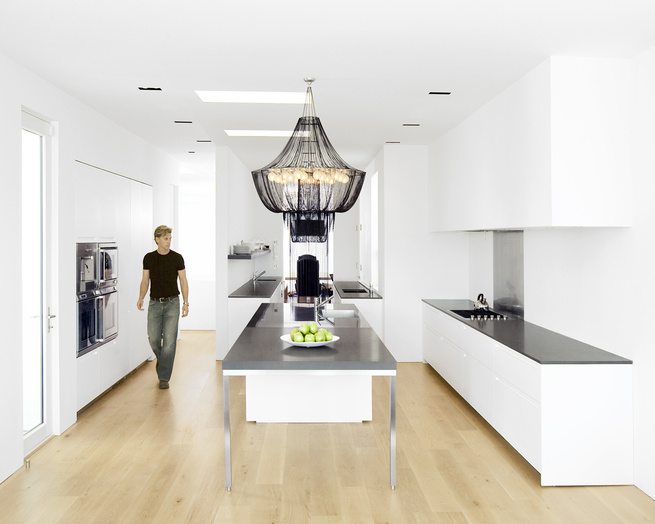"""<p>Hollis designed the kitchen--which features a <a href=""""http://www.boffi.com/"""">Boffi</a> kitchen system and <a href=""""http://www.gaggenau.com"""">Gaggenau</a> appliances-- as three zones. The first centers around the stainless-steel-and-Zodiac-stone island,"""