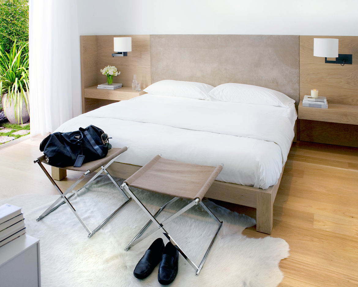 <p>The master suite was relocated from the upper level to the lower level to separate public and private spaces. Hollis designed the custom white-oak bed and suite headboard with built-in bedside tables (fabricated by B Serota Furniture and Architectural