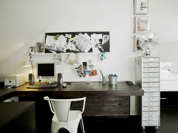 In the office, a Granit filing cabinet stashes supplies and papers, and a bulletin board does double-duty as a 'mood board,' tracking Schonning's inspirations. The back of the desk runs all the way to the floor, concealing the inevitable tangle of cords.