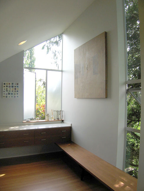 Linear elements like the dressing bench and sink counter connect the areas of the new master bathroom.