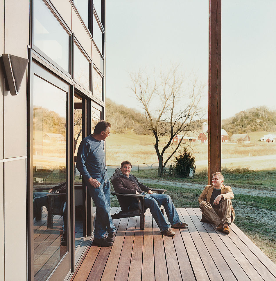 Bill Weber and sons Nick and Wyatt (left) relax on the home's deck.