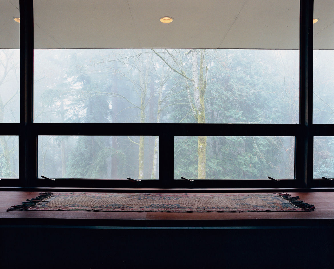 """The architect refers to the huge window opposite the bed as their """"flat-screen television."""""""