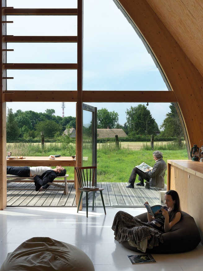 Like the barns Barache scampered through as a child, the house divides its length between loftlike open spaces like the living room, which opens onto a small deck perfect for open-air lolling, and stacked-box nooks and crannies.