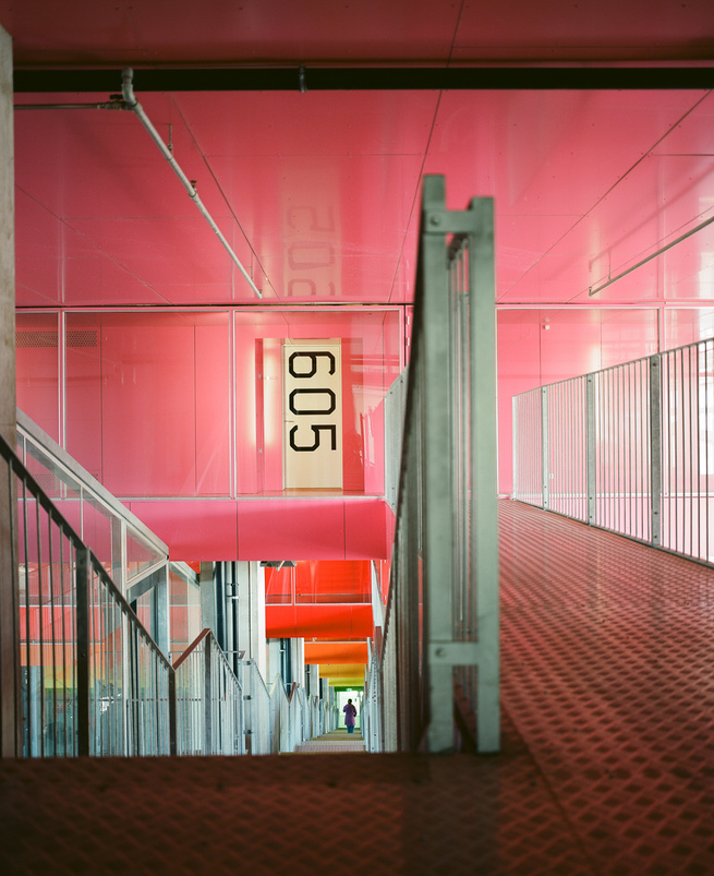 Residents can also ride Denmark's only funicular-style inclined elevator (imported from Switzerland, naturally) to reach their level of residence or drive up to their floor and cross a suspended industrial metal-clad gangplank to reach their hallway.