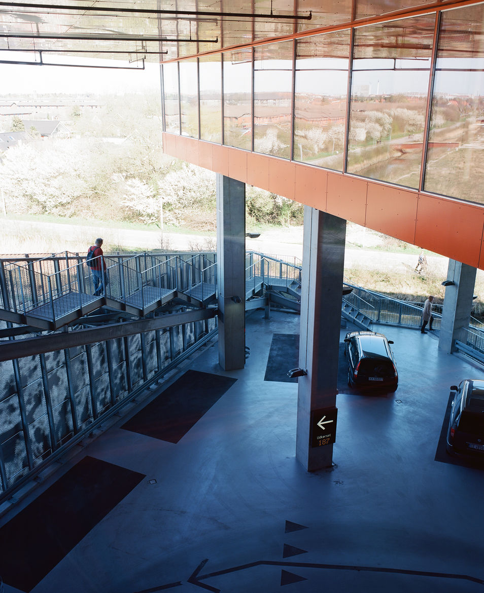 As there's no lobby, the building is always entered through the garage. If residents arrive by foot or bicycle, they can ascend the Mountain Dwellings by walking up a set of metal stairs that climb from south to north over the parking lot.
