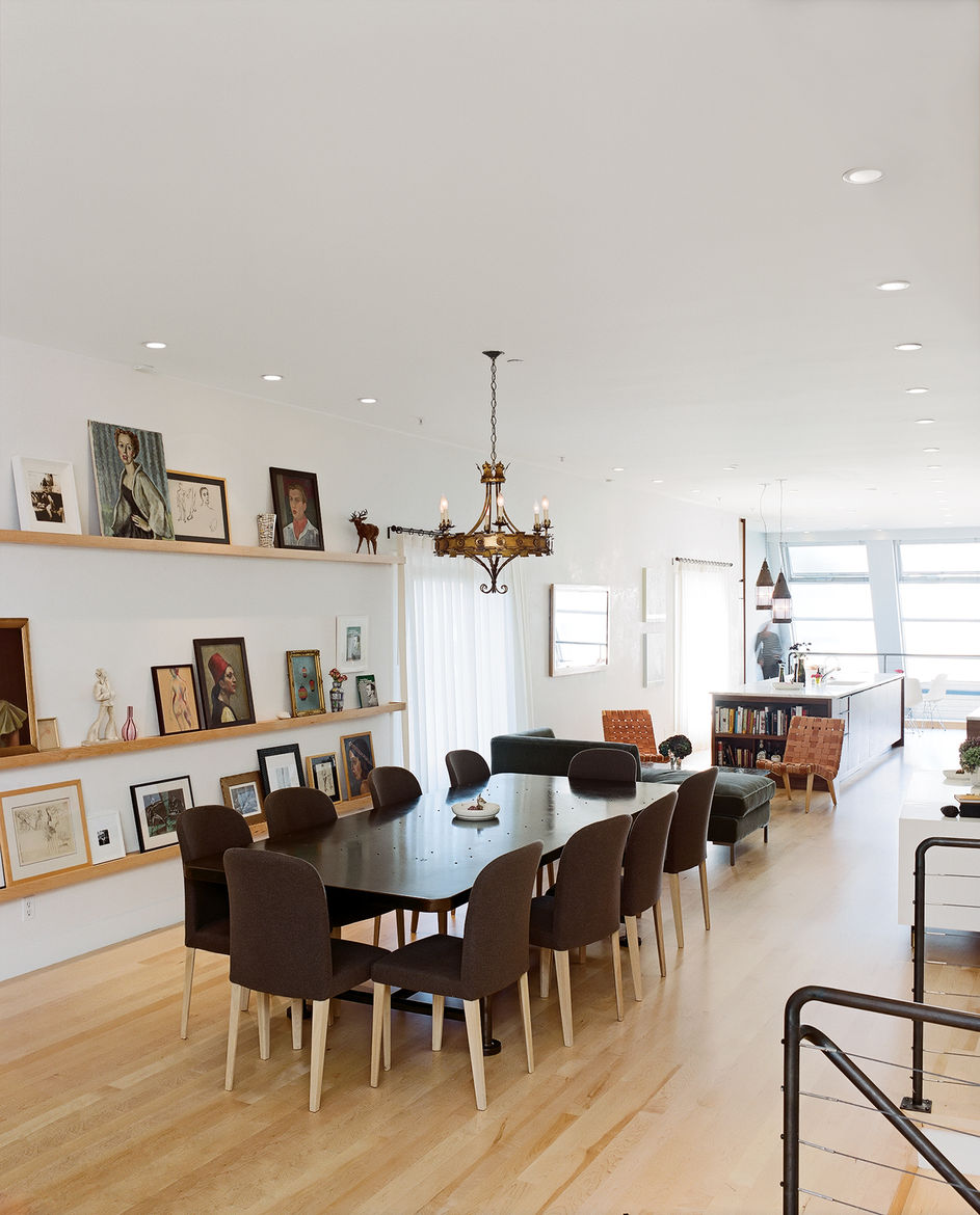 """Molteni dining chairs are overseen by """"someone's"""" ancestral portraits."""