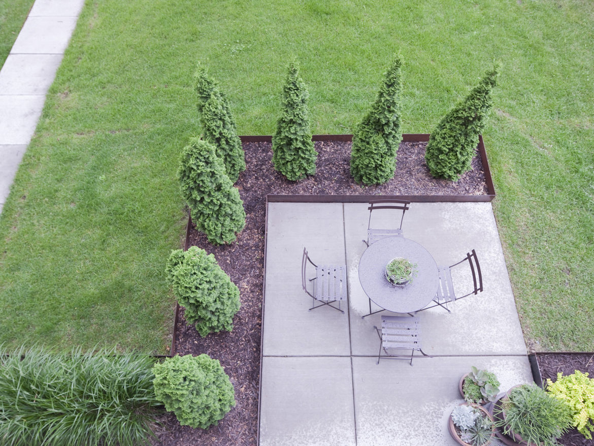 """Here on the patio you can see that rigid grid that Blauvelt so likes at play in the landscape designed by <a href=""""http://www.ro-lu.com/"""">rosenlof/lucas</a>."""