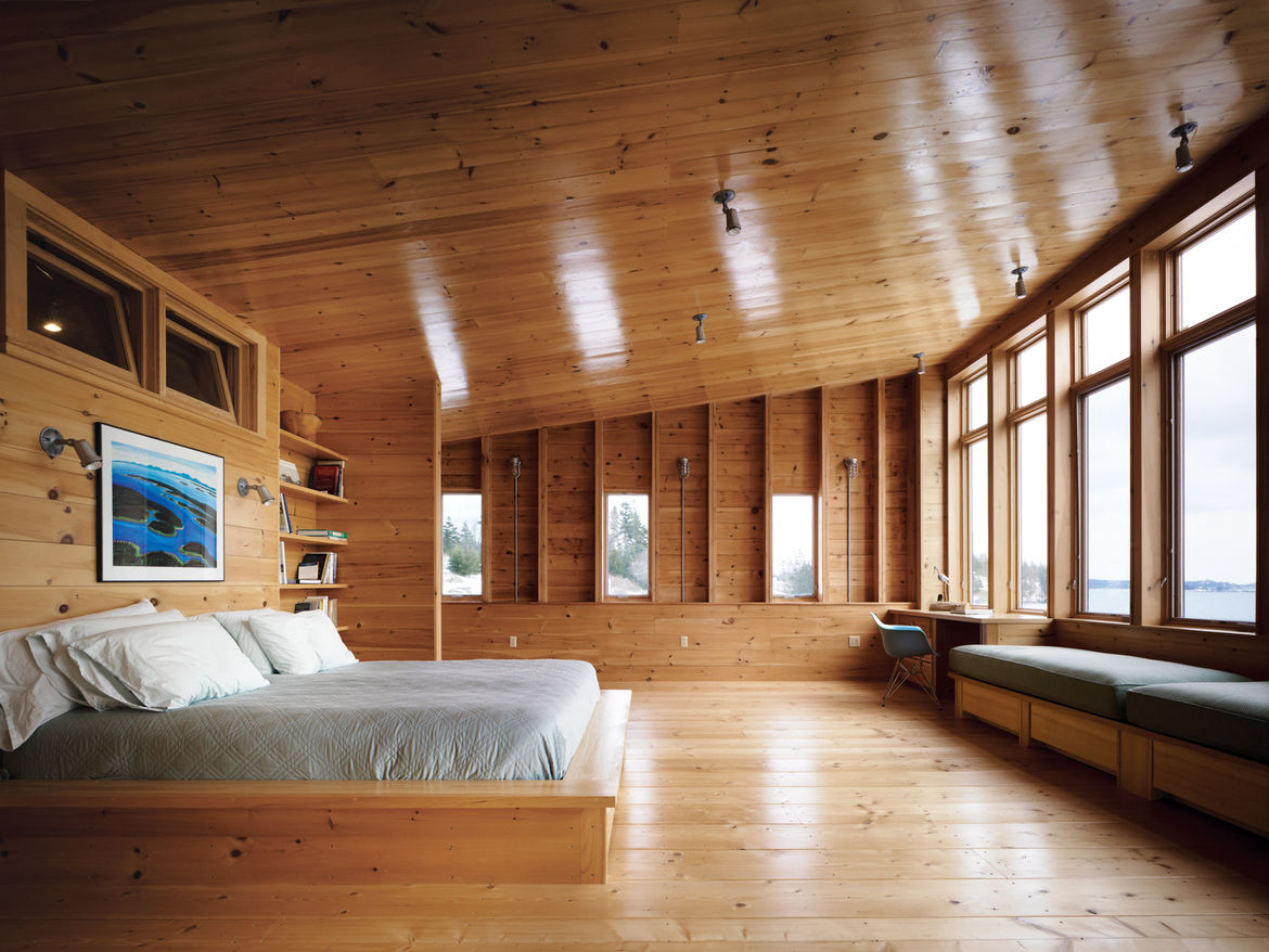 """The master bedroom opens up to the sea """"like a maw,"""" says Callahan, who is delighted with the high ceilings and expansive space. Callahan and Hayes's full-time residence in Fairfield, Connecticut, is a 1734 farmhouse with, as she puts it, """"small, dark roo"""