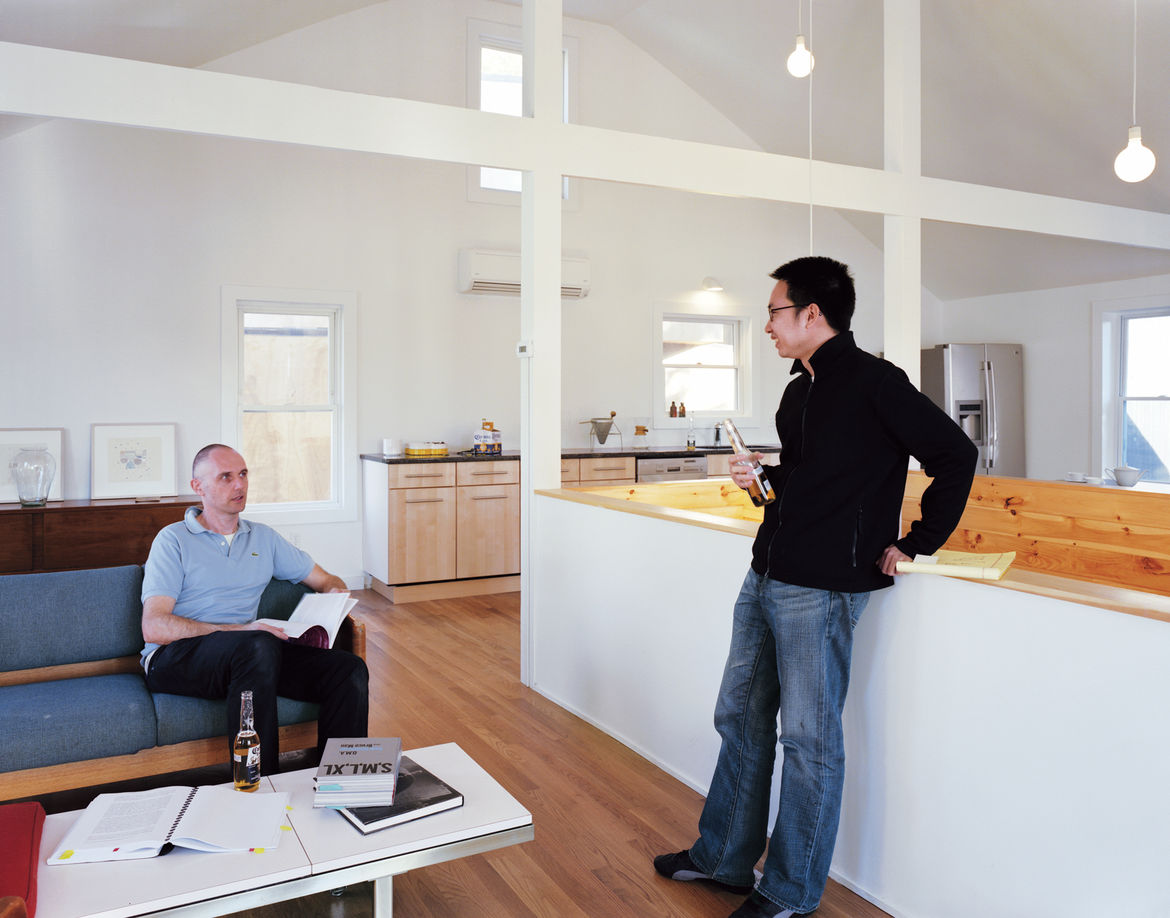 Schenk and Kaewlai on the second floor of Large, where Schenk eliminated the attic and several walls to create a more fluid and open space.