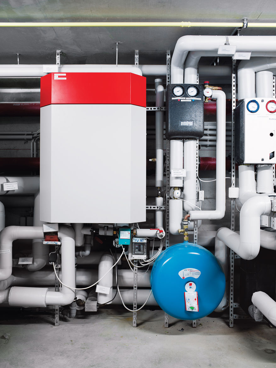 Here, in the basement, a borehole heat exchanger uses the warmth from the earth, brought to the surface by four steel pipes that reach 105 feet down, for heating. Solar panels heat the building's water, and a clever ventilation system ensures that the gla