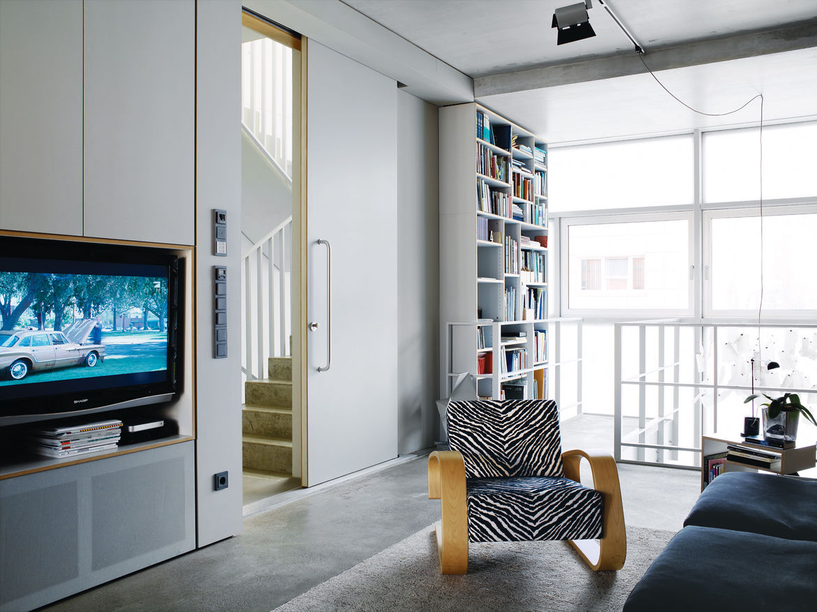 Very large doors, like the one leading from the living area to the stairwell, add to the sense of space.