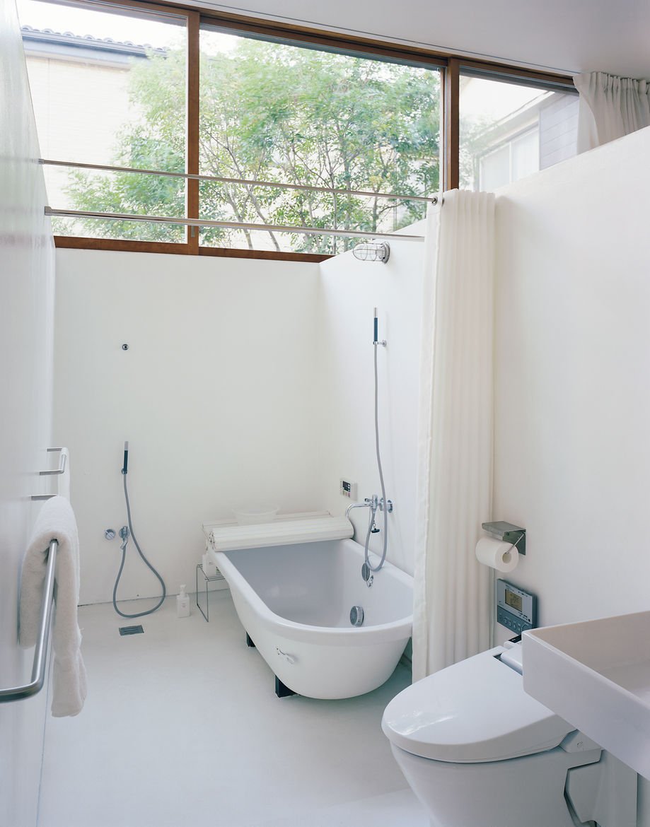 """Even the bathroom can be exposed to the elements—and often is: """"We take a bath with the doors wide open,"""" says Miharu."""