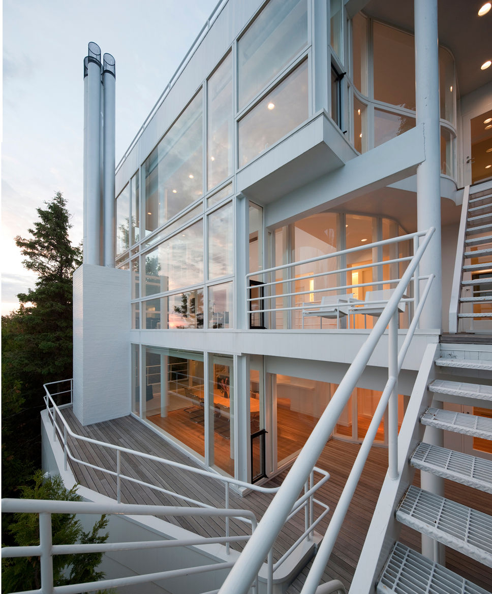 An exterior view of the outside patio, deck and staircases of the Douglas House.