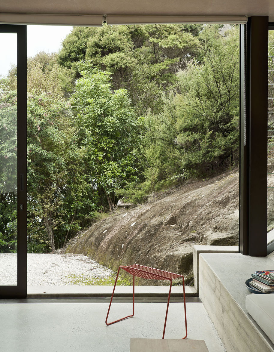 The rock slope just outside is in clear sympathy with the concrete cant inside—nature right alongside architecture.