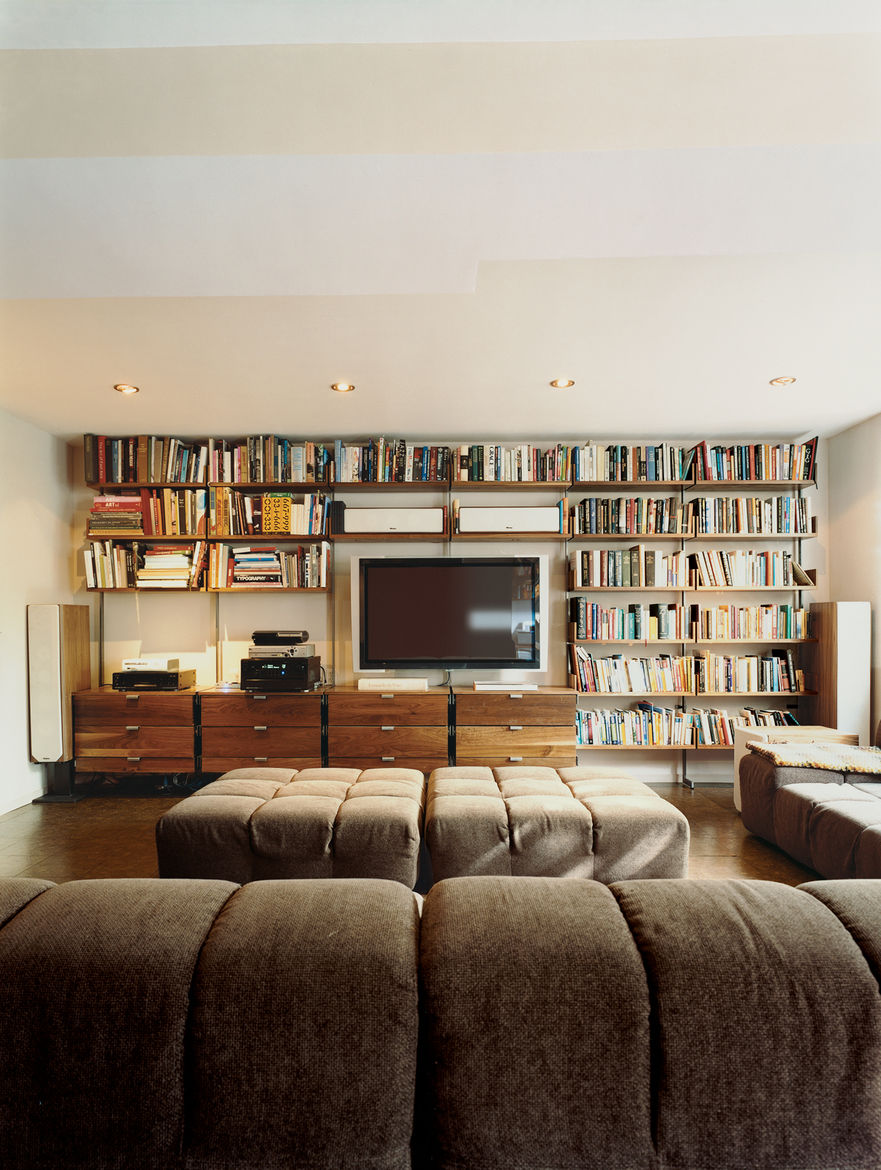 Atlas shelving provides the framework for Farnham's entertainment center. Almost 100 square feet of Patricia Urquiola's Tufty-Time sofa for B&B Italia provides ample space to stretch out.
