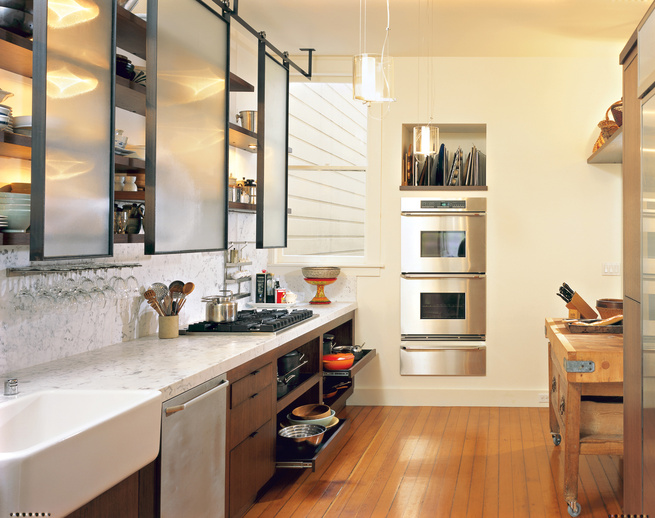 Prized possessions such as the old English butcher's block sit cheek-to-jowl with 21st-century amenities, such as the stacking ovens by Dacor, six-burner Viking stove, and Miele dishwasher.
