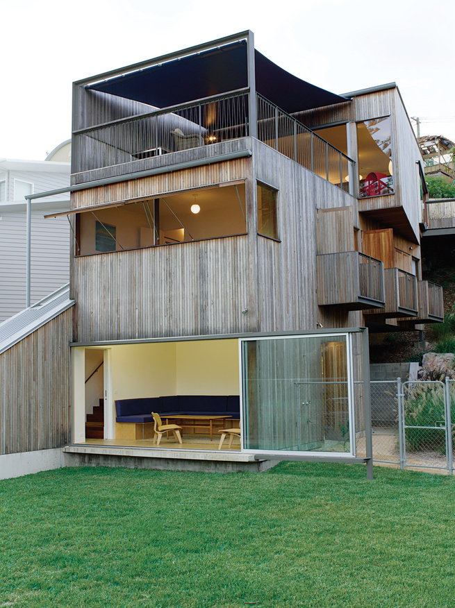 Coastal, on a hill, and made from inexpensive materials, the Ferguson house is a catalog of moving surfaces and open rooms.