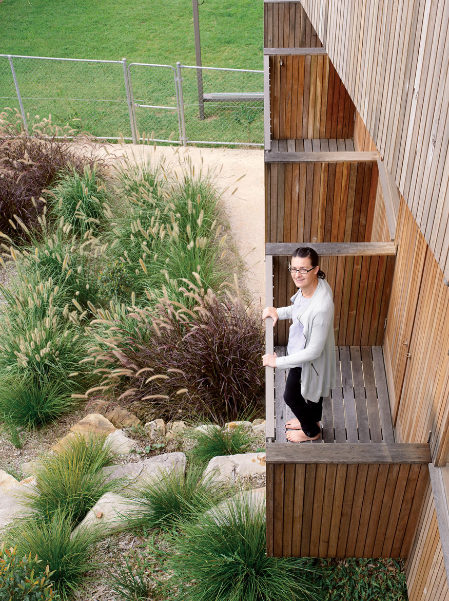 Joanna Ferguson stands on one of the balconies extending from the guest bedrooms.