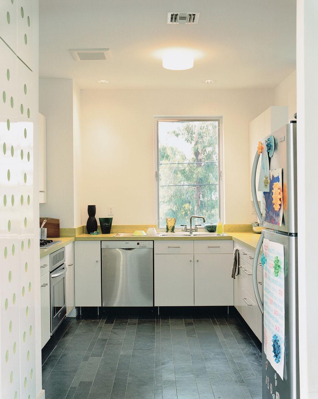 The kitchen is IKEA; the floors, like those in the bathroom, are Brazilian slate.