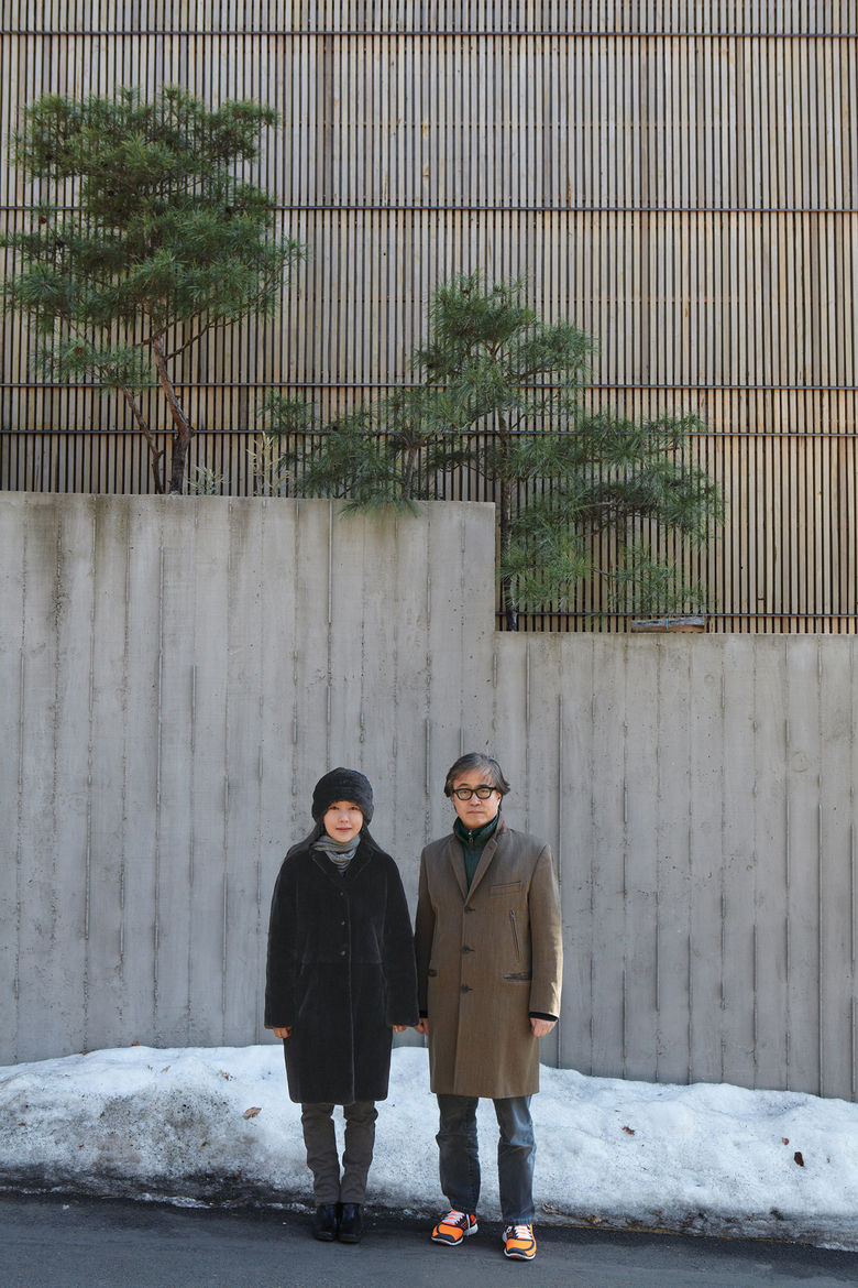 Architect Byoung-soo Cho and his wife, Eunsil Kim, value the privacy, and style, that a concrete wall and recycled Indonesian teak facade provide.