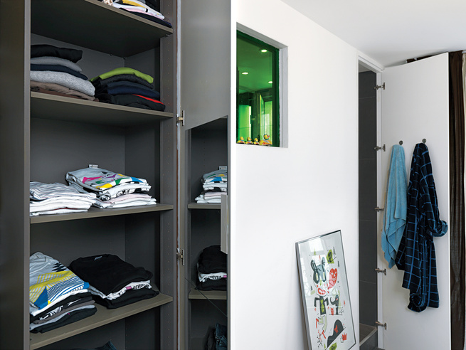 The largest appliances are clustered around the apartment's plumbing core, which abuts the kitchen and bathroom.