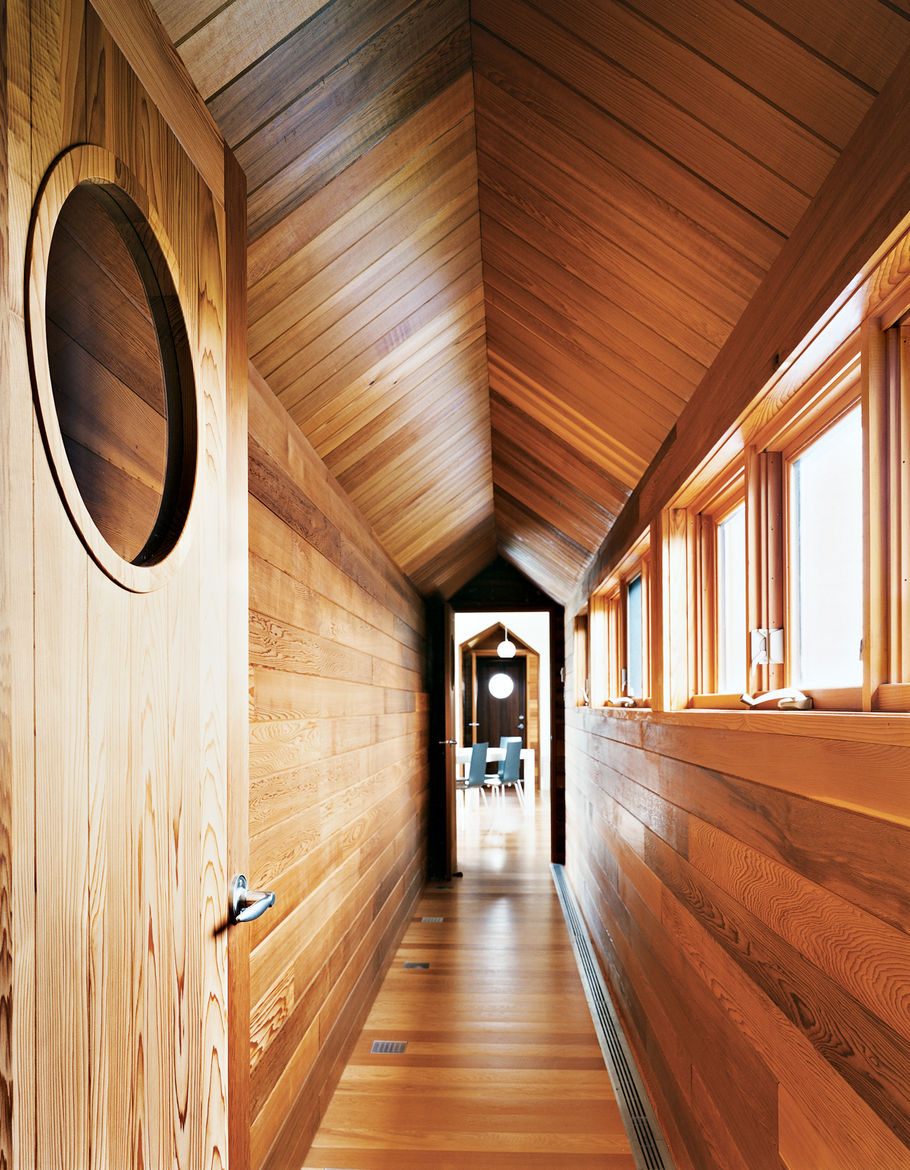 The view from the master bedroom down the long cedar corridor into the living room is one of the home's real pleasures.