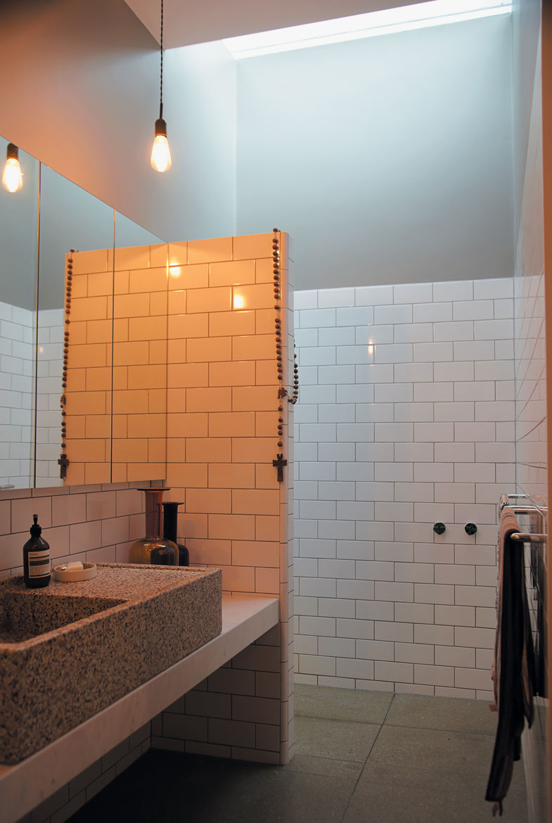 Gorman and Angelucci make use of the en suite master bathroom that sits just behind their inexpensive walk-in closet with messmate facing.