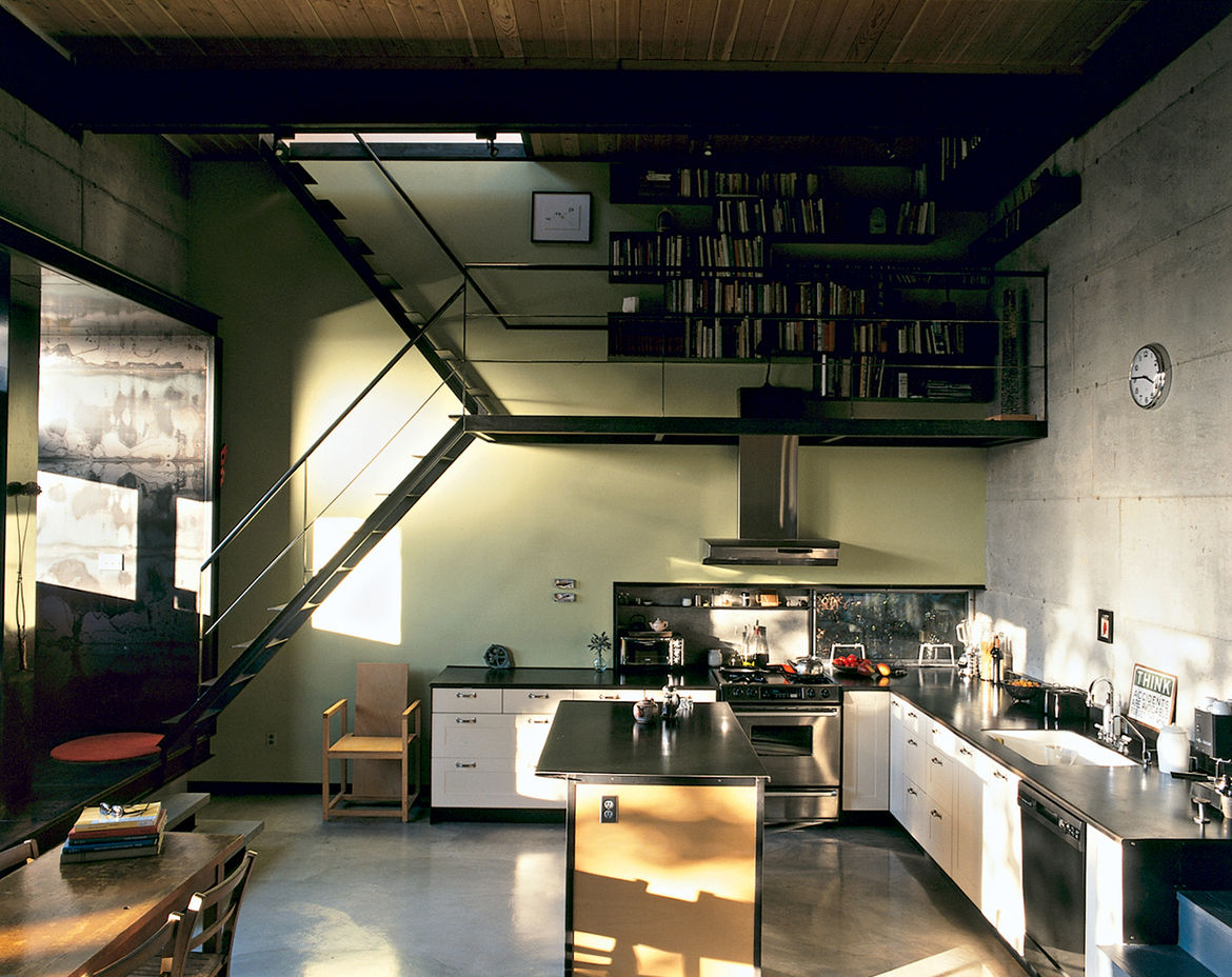 """All of the plywood, concrete, and steel surfaces inside the house were left unfinished. """"We like to use natural materials in their raw state and minimize the use of synthetic surfaces and drywall,"""" says Mihalyo."""