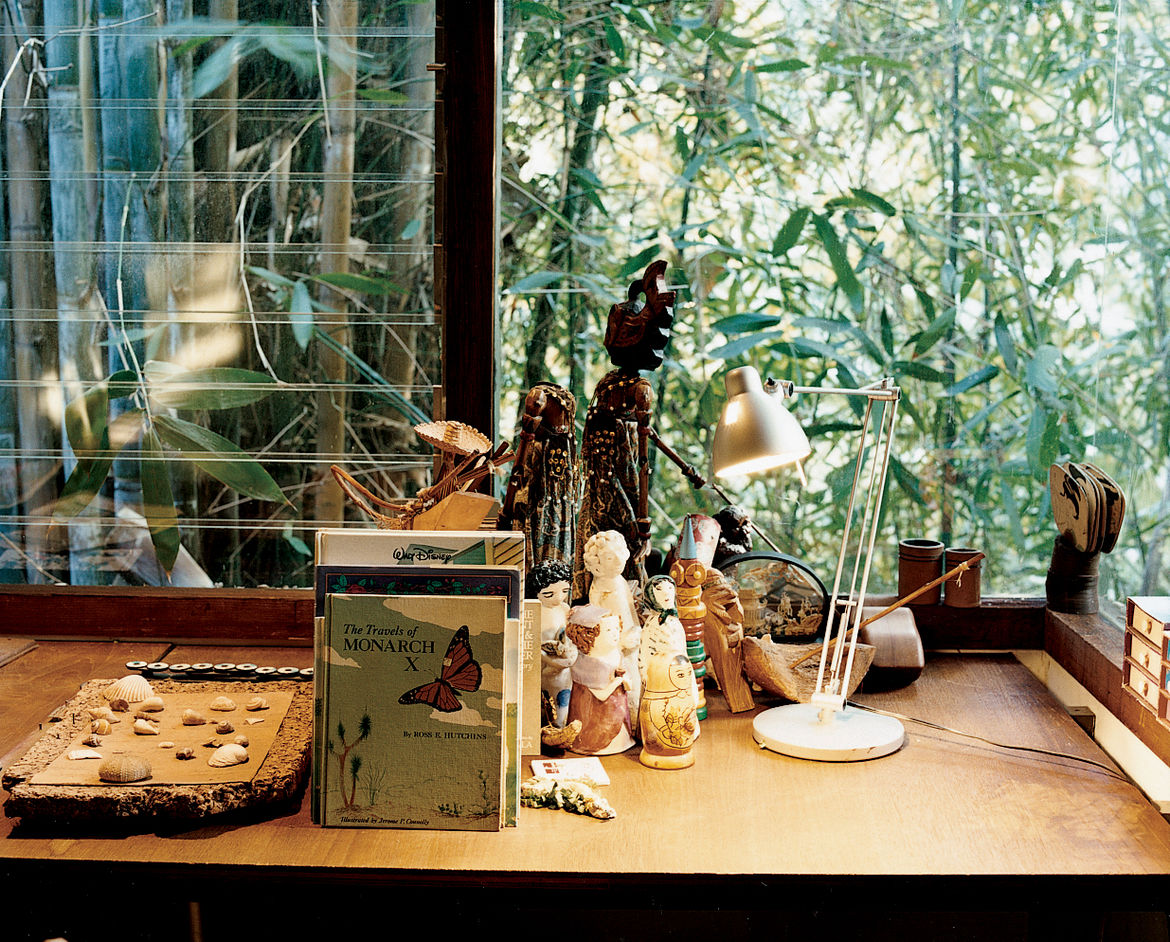 The grandchildrens' room, on the same, well-lit side of the house as Ray's office, is adorned with dolls and books.