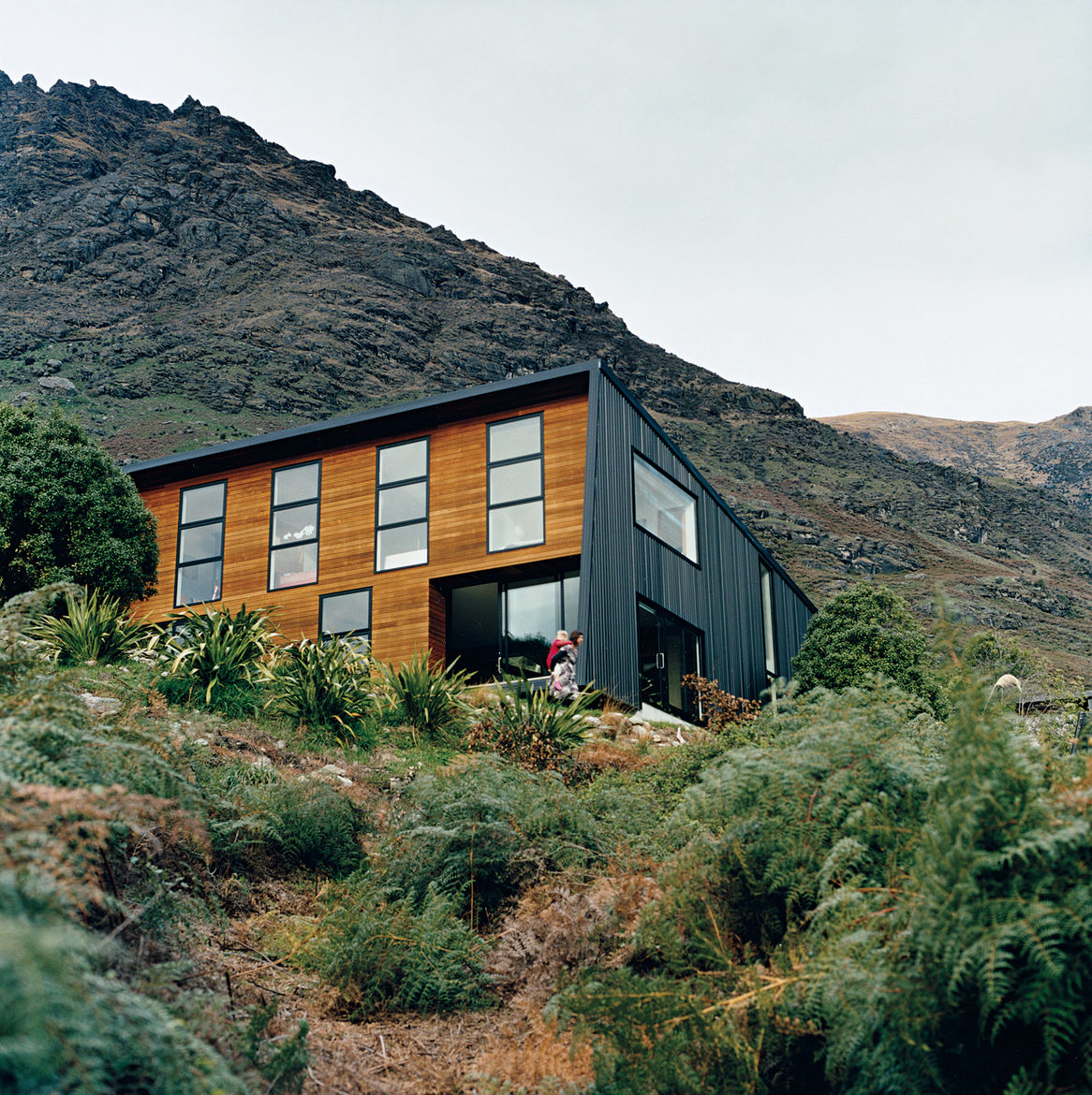 The location on the shores of a small bay means it is sheltered from cold southerly winds. The alpine location provided plenty of inspiration for landscaping, which Ritchie and Kerr elected to keep as minimal as possible, as if the home had landed on its