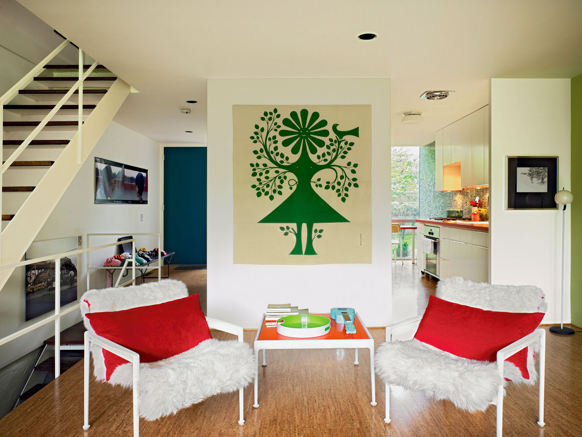 A Richard Schultz outdoor set for Knoll looks at home indoors thanks to some faux fur, and an Alexander Girard Environmental Enrichment panel does its job on the rear wall.