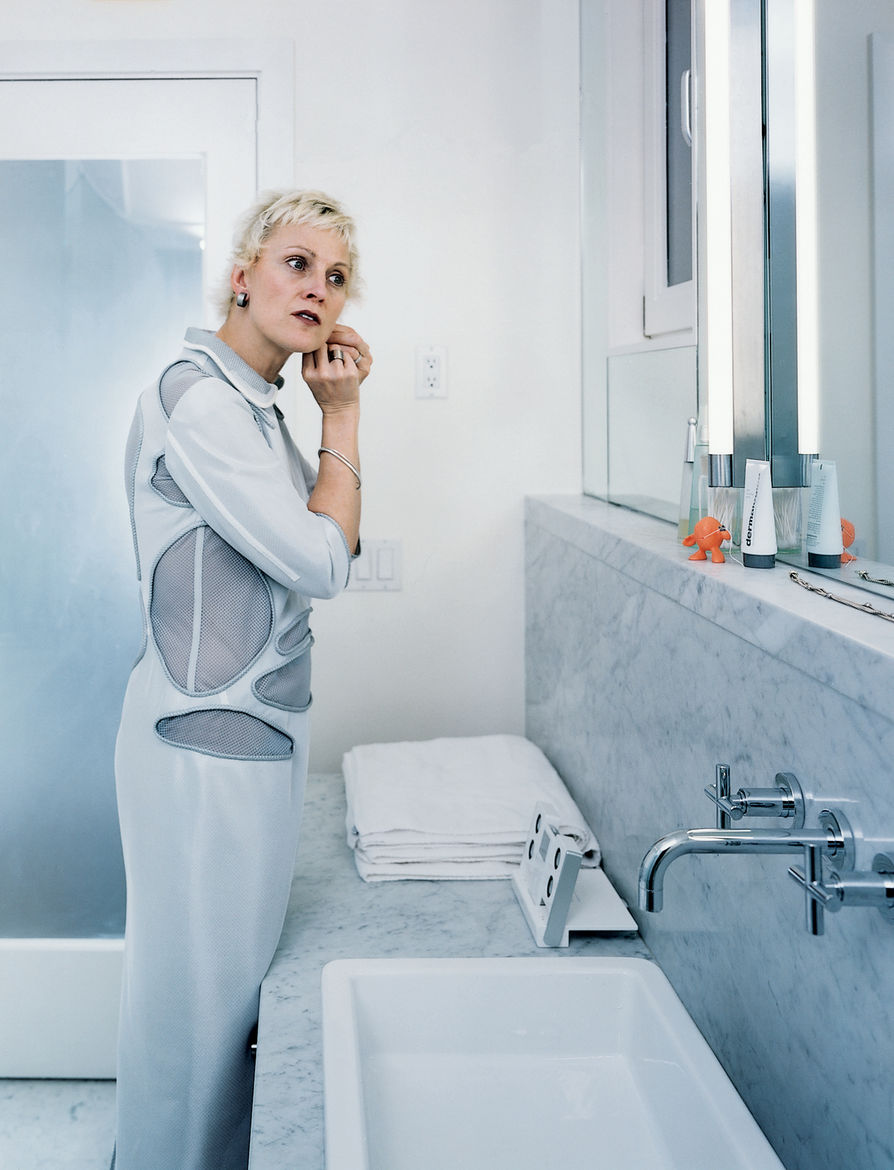 """Because it's a small space, it was possible to make everything pristine,"""" says Dulkinys, standing in her dream bathroom, outfitted with full-slab Carrara marble, a Duravit sink, and fixtures by Dornbracht."""