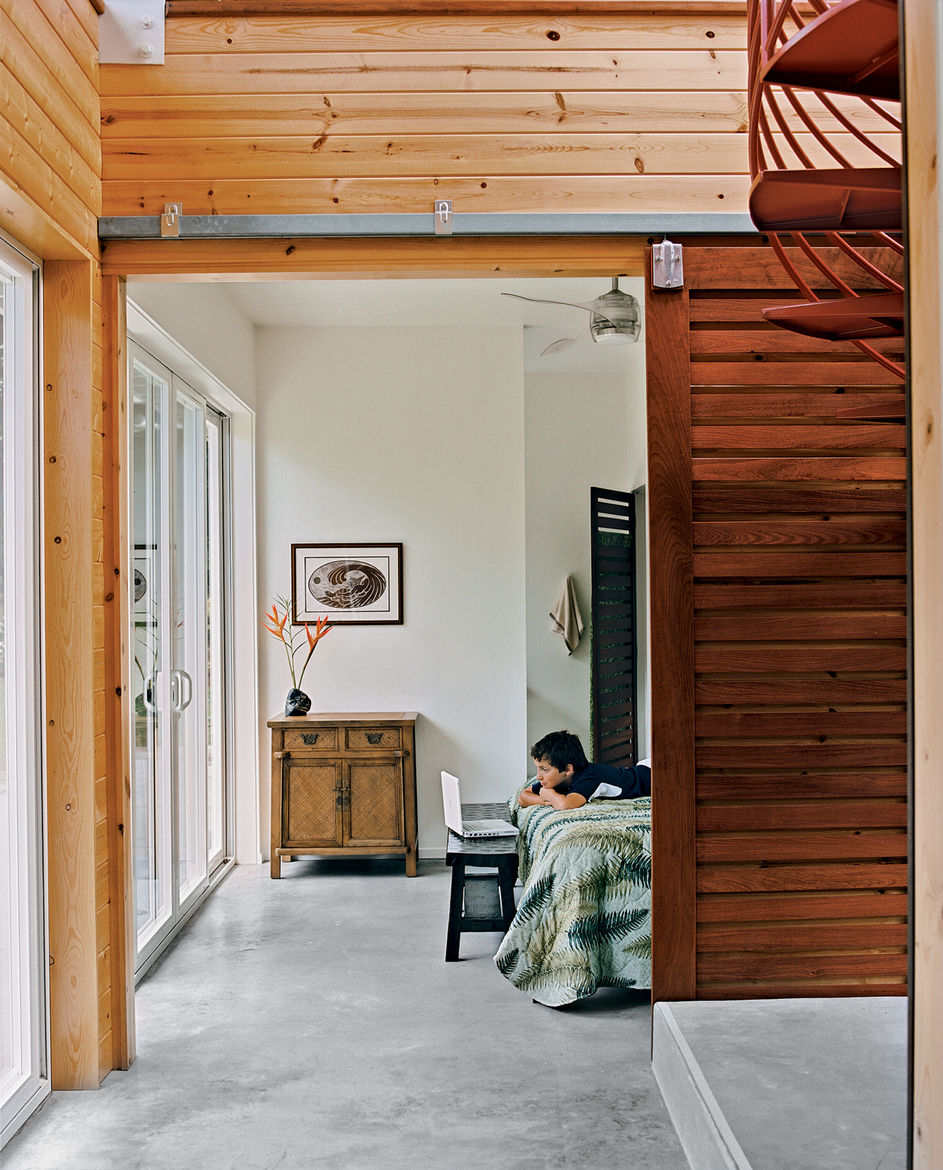 Kurokawa and Fishman's son Danny Fishman-Engel enjoys time away from the city by studying magic tricks in his bedroom. Sliding slatted doors separate the asymmetrical downstairs spaces.