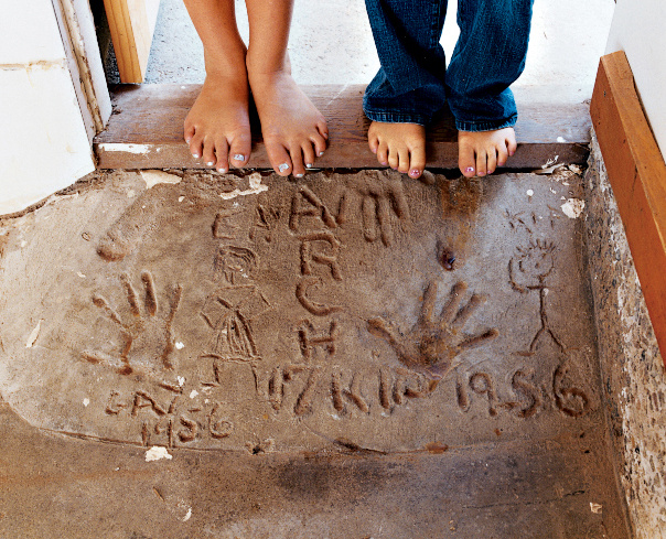 Madeline and Gabriella check out the handprints of their grandmother and granduncle, which were cast in the original foundation in 1956.