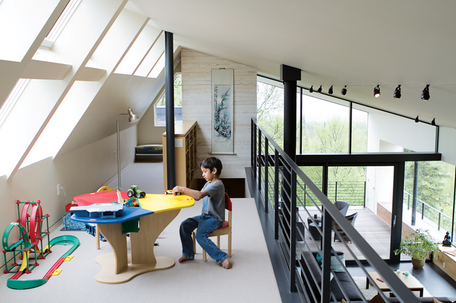 The loft above the living room in the Leiniche Navitsky residence featuring clerestory windows.
