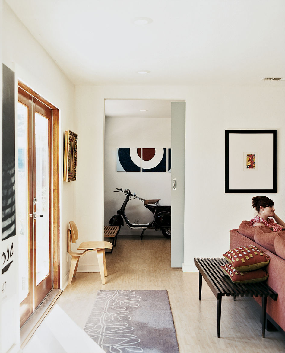 """Light spills in from the double doors Lucky installed, which lead to the front yard and recall the Southern Californian tradition of indoor/outdoor living. """"To us, our furniture is the art inside the house,"""" says Lucky. """"The Vespa, for example, is a piece"""