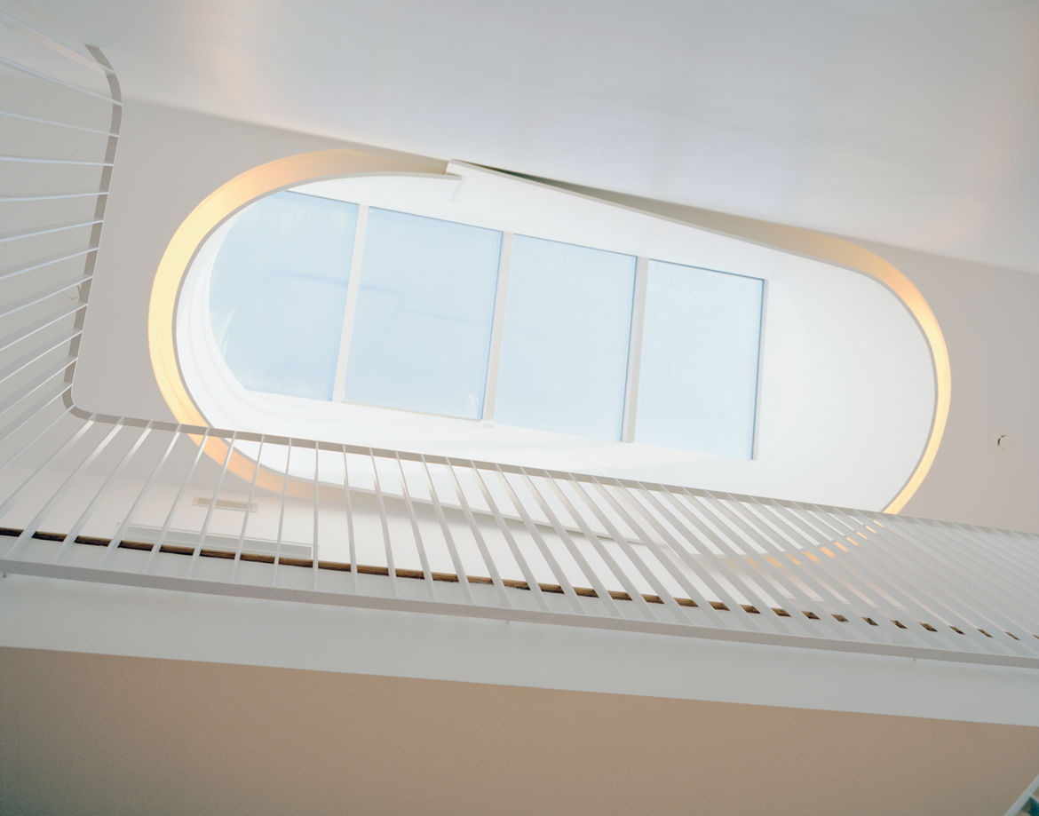 Briggs and Knowles based their design of the oculus on traditional Victorian skylights but tweaked it to fit a more modern sensibility and outfitted it with fluorescent tubing to recreate the effect in the evening.
