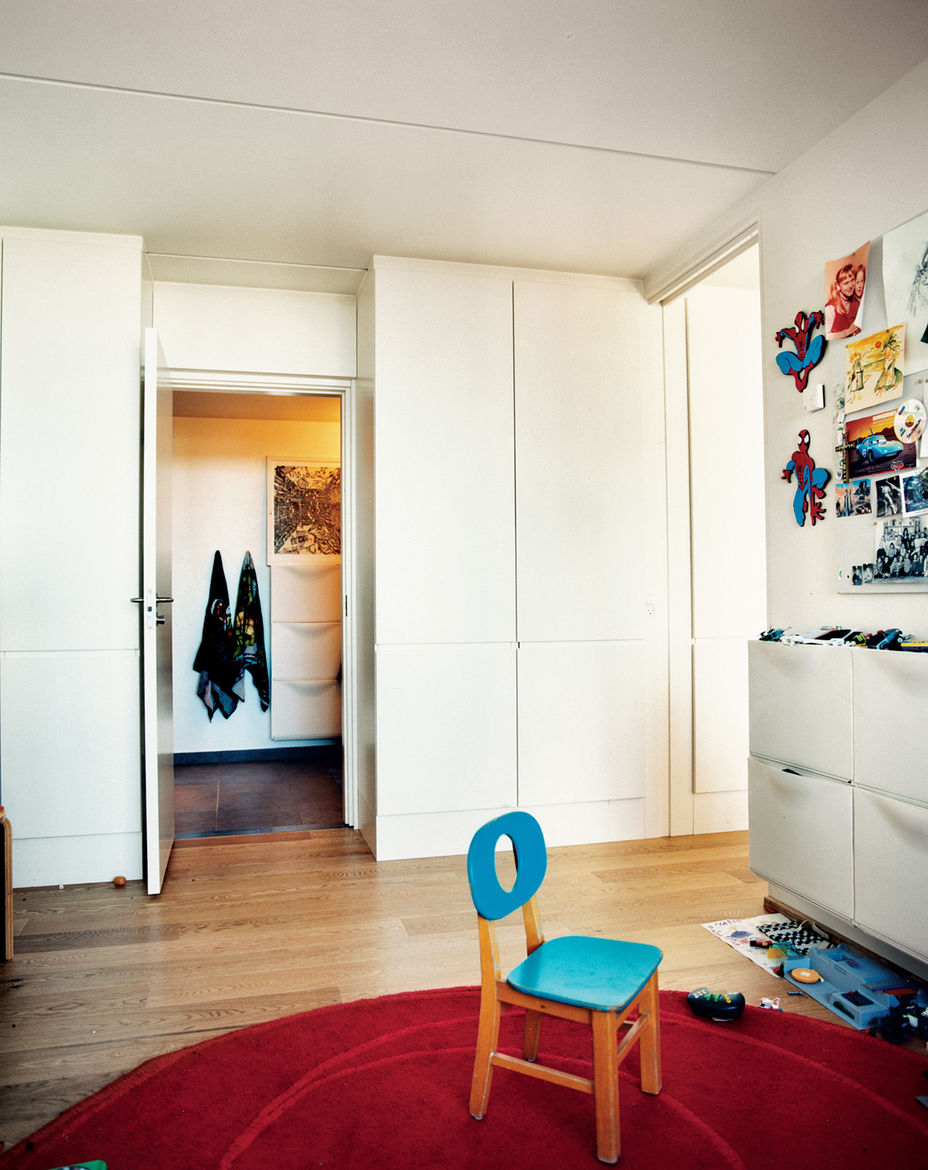 The kids occupy the bedroom, which is small but generously daylit. Of the modest overall size of the place, Zahle says the layout belies the square footage, adding that his kids love it because they can run around outside in the summer.