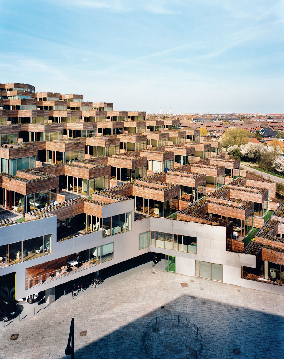 "Every apartment has a terrace measuring around 1,000 square feet, with both private and semipublic spaces. ""The cool thing about a garden is it's yours,"" says architect Bjarke Ingels. ""If you're on the wooden part, you can suntan in your bikini bottom or"