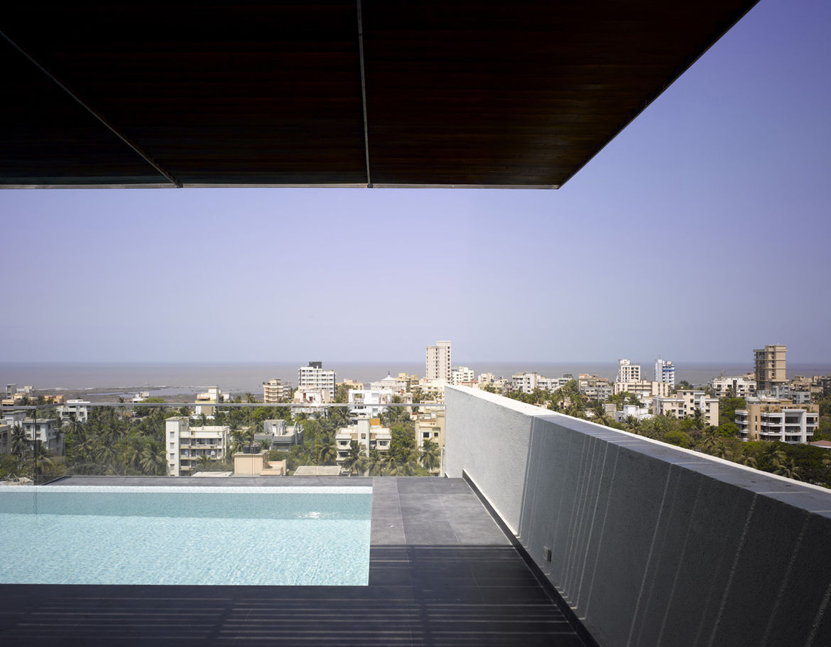 Khanna and Schultz introduced a deep, cantilevered overhang to the owner's terrace, which has a pool and a view of the city and the Arabian Sea.