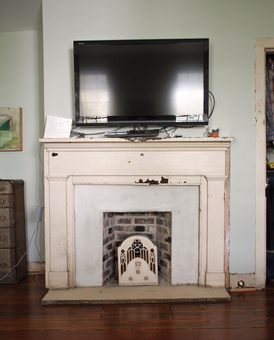 One of six fireplaces in the Rice and Nissenboim residence, this one featuring a television.