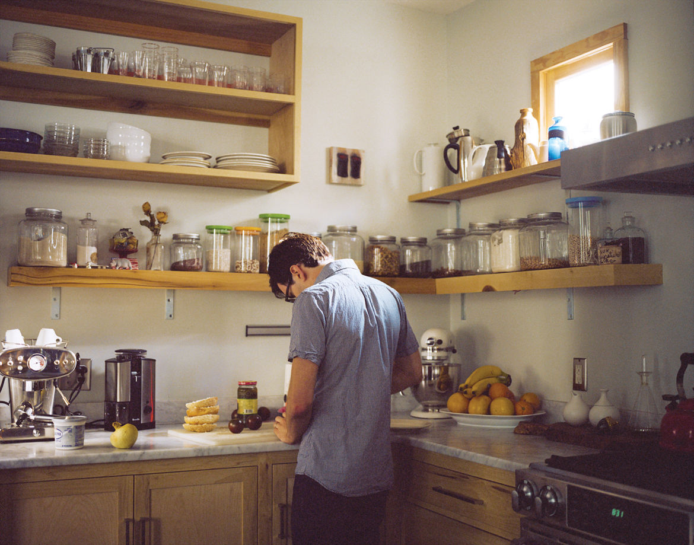 Josh Nissenboim preparing food in his kitchen.