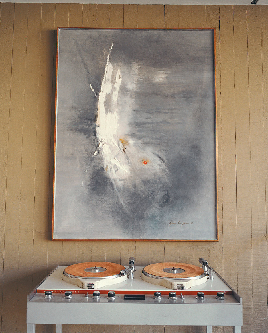 Stevens pared down his collection of vintage furniture and art considerably when he bought the Opdahl house, but he saved critical pieces such as this Gene Cooper painting.
