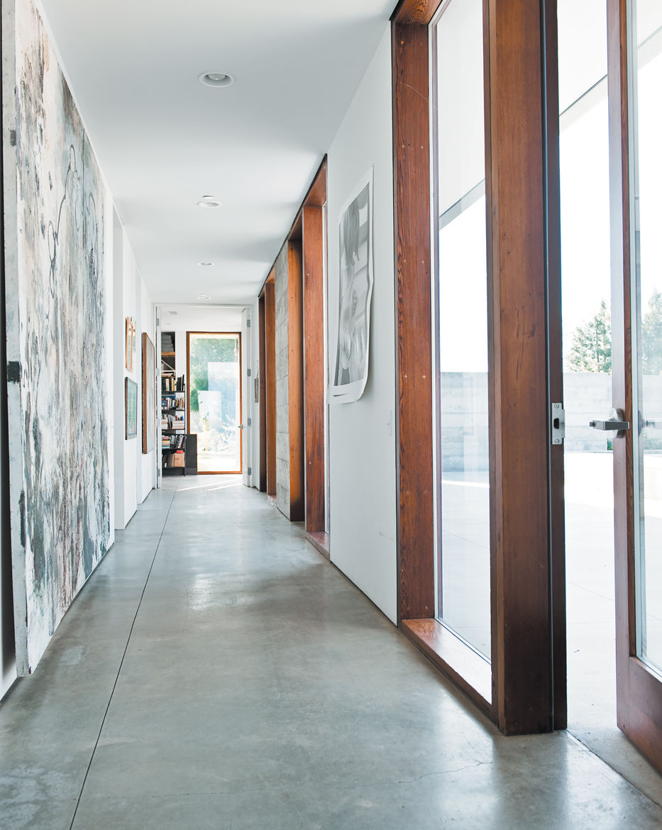 The long hallway leading to the bedrooms gets spectacular afternoon sun, lighting up the family's many works of art.