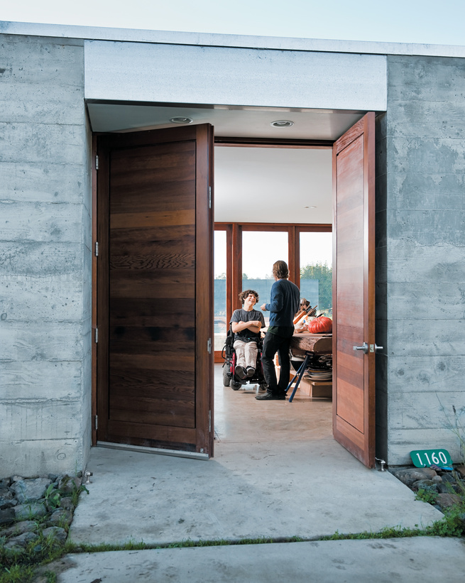 The wide front door opens onto a wide central living space where the entire family—and a regular cast of visitors—spends much of their time.