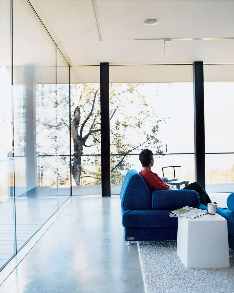 """The floor-to-ceiling windows in the living room give the impression of being outside even while cozily enjoying a cup of tea inside. All the windows in the house are double-paned and filled with argon gas. Petra Sattler-Smith says that """"even when it's 10"""