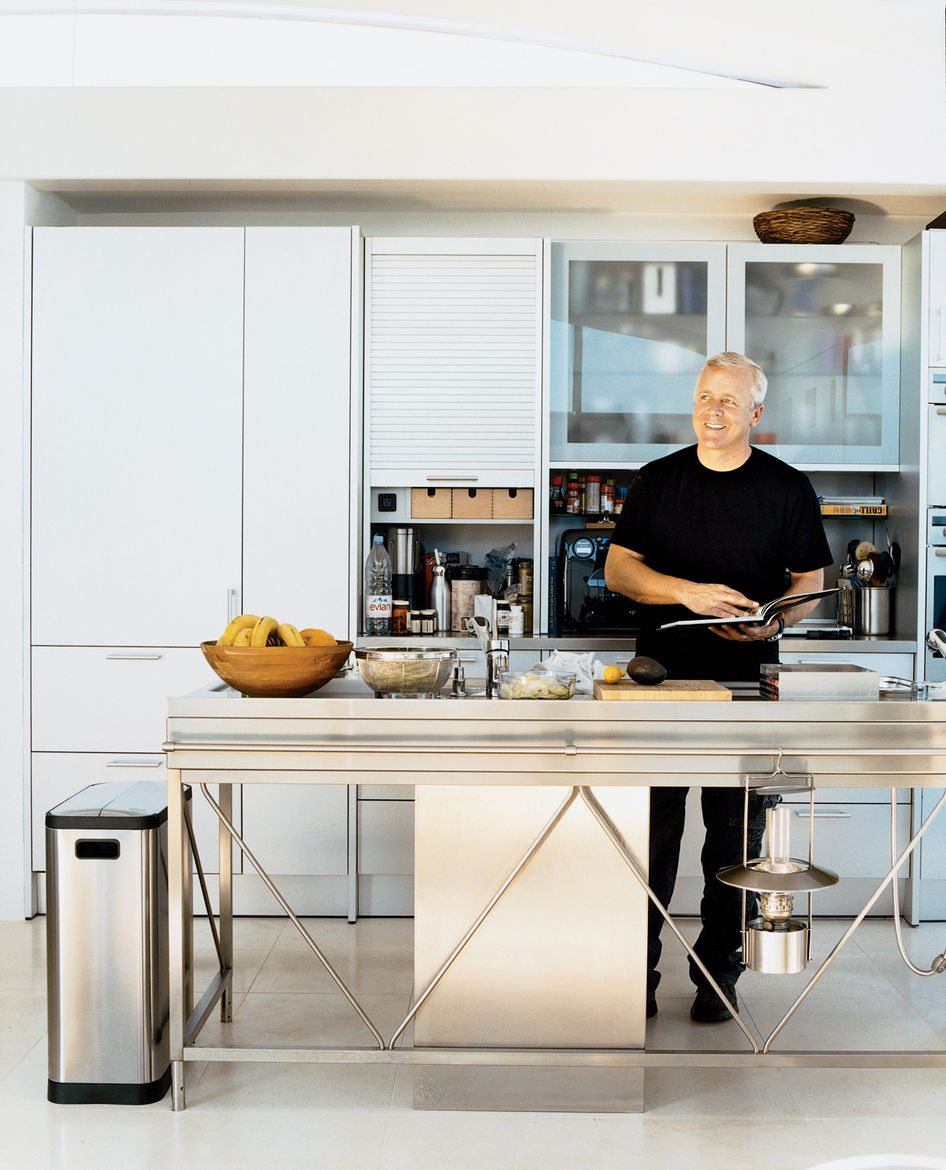 Opening onto the open-plan living and dining rooms, the aluminum Bulthaup System 20 kitchen with its nine-foot-long stainless steel island and Miele appliances has become a focal point of the house. Pressed in one seamless sheet of steel, the island, Pica