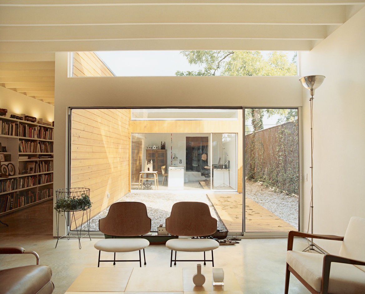 """The house is organized around three courtyards. The largest serves as an outdoor room between the living space and Baum's office, which he calls the """"flex room."""""""
